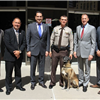 dog with deputy and board